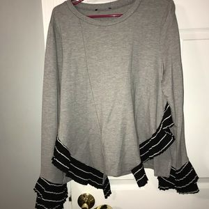 Gray long sleeved shirt with black and white trim